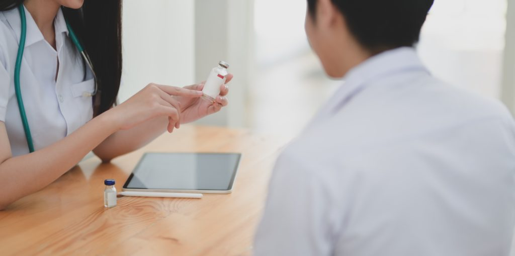 Photo of doctor explaining medication to patient